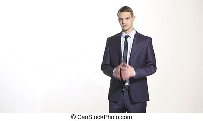 body language. man in business suit isolated white background. Training managers. sales agents. linked fingers. middle position. a gesture of frustration.