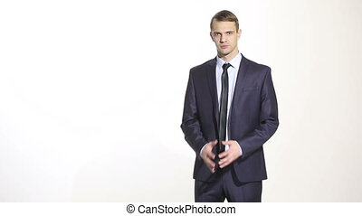 body language. man in business suit isolated white background. Training managers. sales agents. linked fingers. lower position. a gesture of frustration.