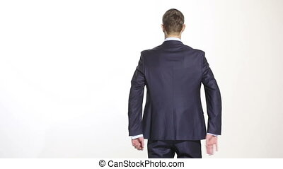 body language. man in business suit isolated white background. Training managers. sales agents. hands behind his back. grasping the wrist. gesture of self-control and anger