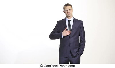 body language. man in business suit isolated white background. Training managers. sales agents. gesture of dominance. focus on thumb. excellence