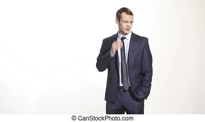 body language. man in business suit isolated white background. scratching, rubbing the ear. gesture of distrust speaker