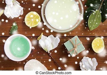 body lotion, cream and handmade soap on wood