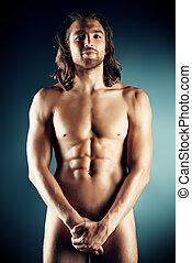 body man - Sexual muscular nude man posing over dark...