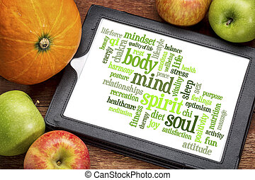 body, mind, spirit and soul - word cloud on a digital tablet