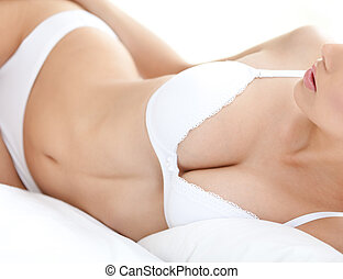 Body of a halfnaked woman in white bra - Body of a halfnaked...