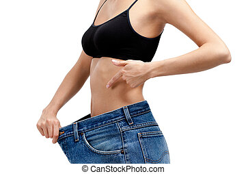 Body of a slim girl wearing big jeans, isolated on white