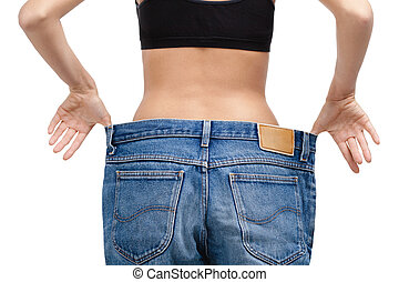 Body of a slim girl wearing enormous jeans, isolated on...