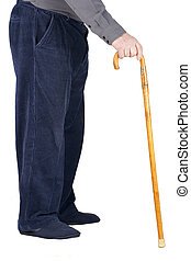 Body of senior man leaning on cane - Profile of bottom half...