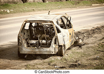 Body of the burnt car in the street.