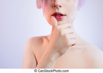 body part portrait of beautiful young woman touching her lips