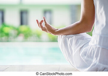 Body part - Woman in lotus position close up