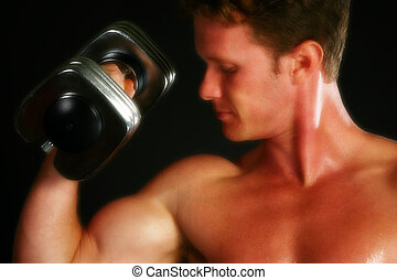 Body - Attractive thirty something man lifting weights over...