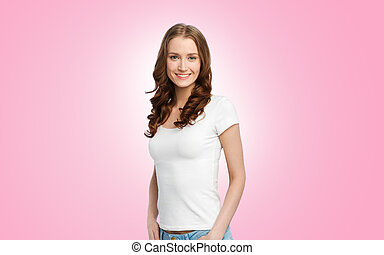 happy slim woman in white t-shirt over pink