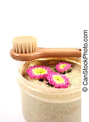 Body scrub and brush. - Spa and beauty products isolated on...