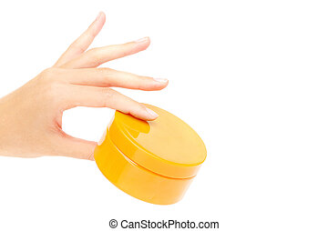 Body scrub - Female hand holding container with cream or...