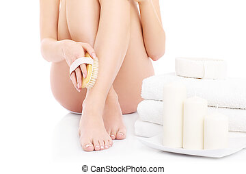 Body scrub - A picture of a woman doing peeling with a brush...