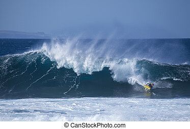 bodyboarding at El Confital beach, Gran Canaria, December...