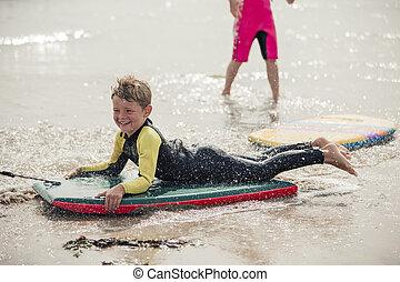 Bodyboarding at the Beach