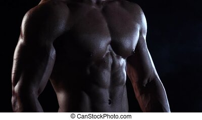 Bodybuilder demonstrates his body, strength and endurance....