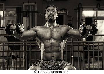 Bodybuilder Doing Exercise For Shoulders