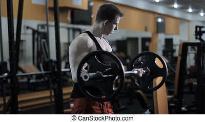 bodybuilder doing exercises with barbell