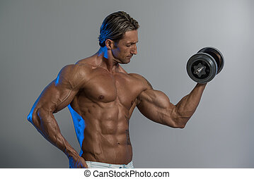 Bodybuilder Exercising Biceps With Dumbbells On Grey Background