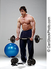 Bodybuilder lifting some weights 2