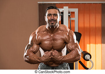 Bodybuilder Making Most Muscular Pose