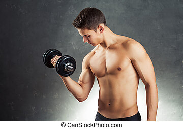 Bodybuilder man exercising with dumbbell