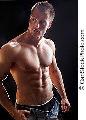 Bodybuilder man isolated on black background. Studio shot