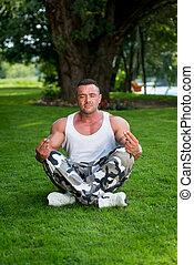 Bodybuilder Meditating