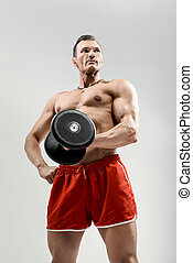 bodybuilder on grey background