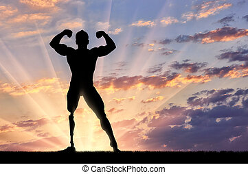 Bodybuilder paralympic on sunset background - Paralympic...