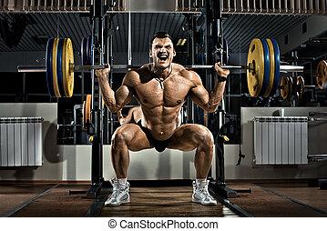 bodybuilder - very brawny guy bodybuilder , execute exercise...