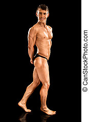 Bodybuilder Posing on Black