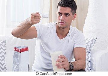 Bodybuilder preparing protein shake - Handsome bodybuilder...