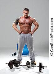 Bodybuilder relaxed, posing 2