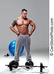 Bodybuilder relaxed, posing