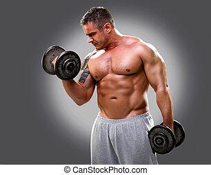 Bodybuilder with a tattoo lifting dumbells, closeup 2