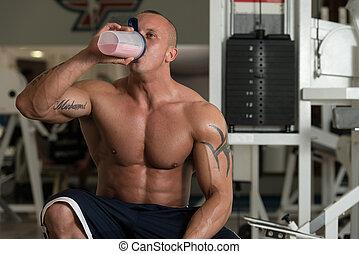 Bodybuilder With Protein Shaker - Handsome Muscular Man...
