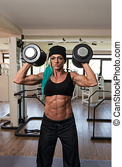 Bodybuilder Woman Doing Heavy Weight Exercise For Shoulders...