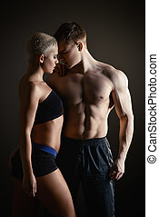 bodybuilders - Beautiful athletic couple posing together...