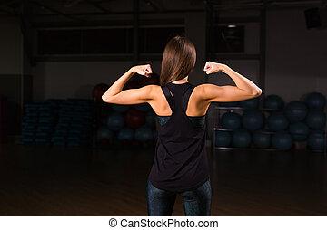 bodybuilder's, biegen, weibliche , muskulös, zurück