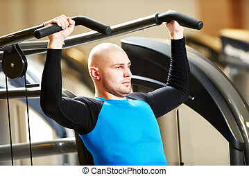 bodybuiler man at gym have a fitness workout