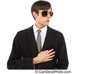 Bodyguard - Caucasian male bodyguard wearing sunglasses and...