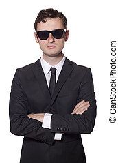 bodyguard with glasses and folded arms, isolated on white