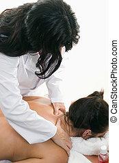 Bodywork - Therapist giving a back and shoulder massage