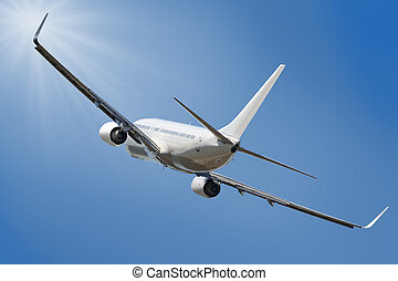 Boeing 737 jet aeroplane landing through sky with clipping...
