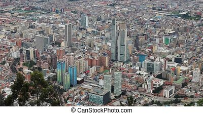 City of Bogota, Colombia on dull overcast day, camera tilting up