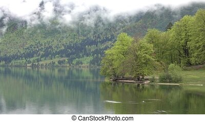 Bohinjsko jezero between mountains in Slovenia at morning ...